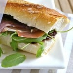 Prosciutto Fig Arugula Sandwich on a white plate