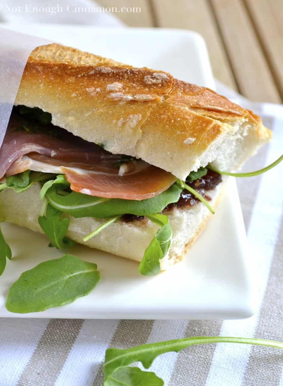 Prosciutto Sandwich with Pesto, Arugula and Fig Chutney - the perfect easy sandwich for a delicious lunch. A crusty French baguette topped with salty, savory prosciutto, basil pesto,  arugula, and a smear of homemade fig chutney for sweetness. #sandwich, #healthy, #lunch, #easy, #pesto, #French