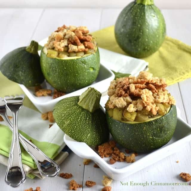 Zucchini Parmesan Crumble served in a baked 8-Ball Zucchini with crunchy Parmesan topping