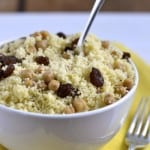 Couscous with Chickpeas and Raisins served in a white bowl