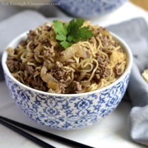 Asian Beef Noodles served in a Chinese noodle bowl with a fresh cilantro leave on top
