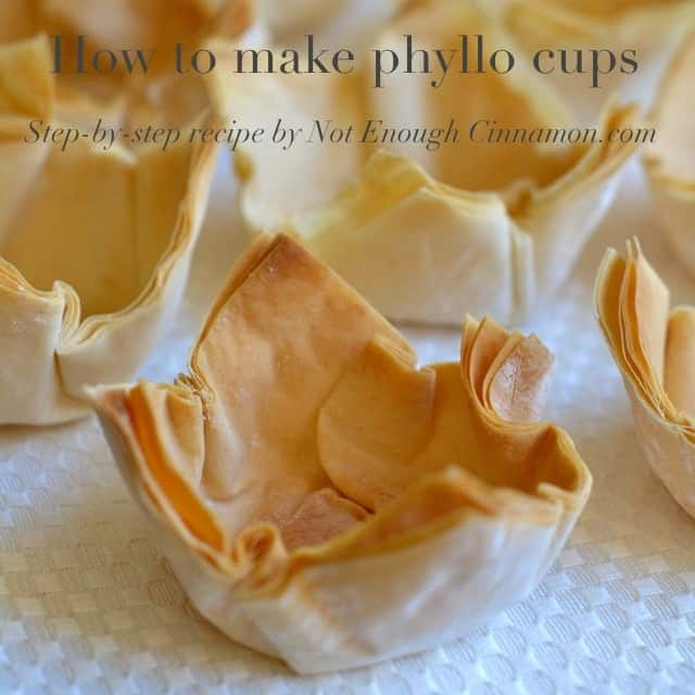 crispy golden brown phyllo cups lined up on a white table, ready to be filled