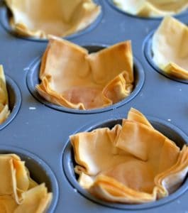 homemade phyllo cups in a muffin tray fresh out of the oven and crispy golden