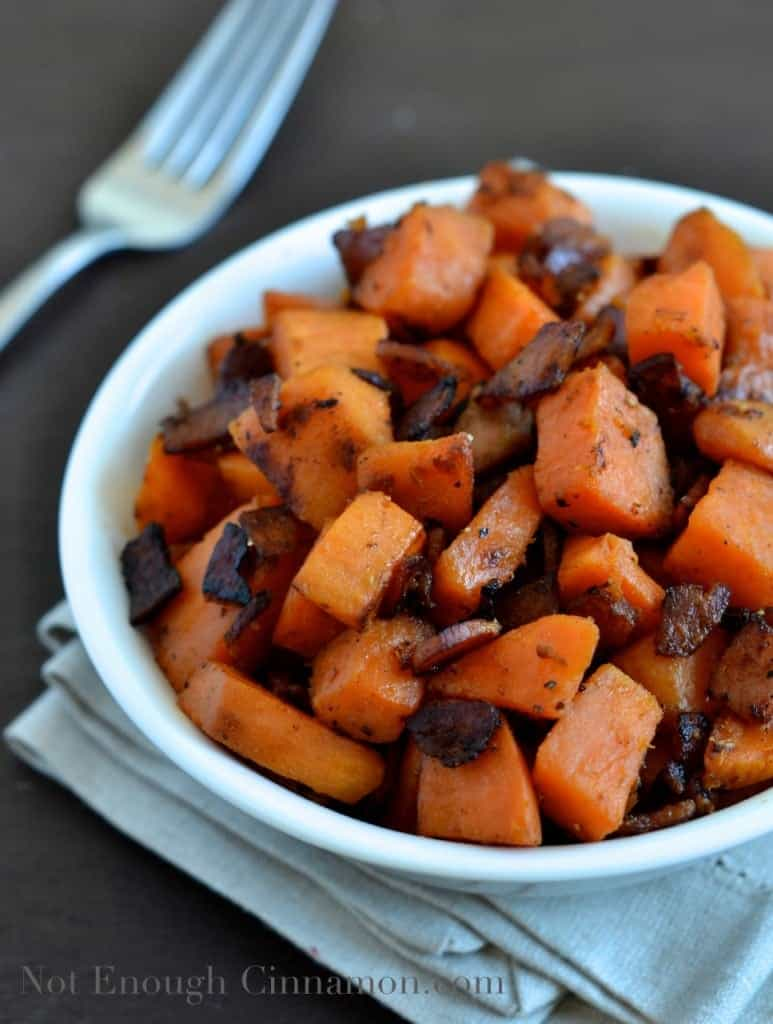 Bacon and Sweet Potato Skillet served in a small white bowl with a lot of crunchy bacon on top