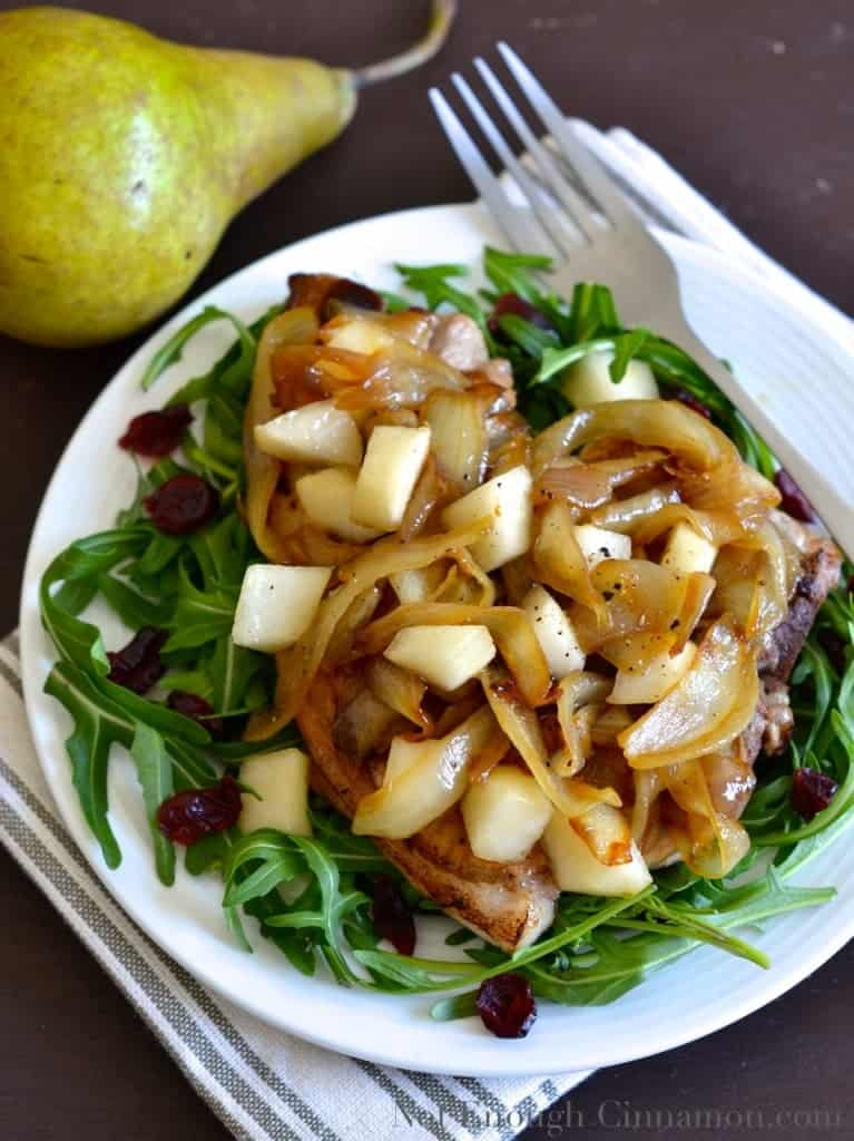 Pan-Seared Pork Chops topped with Pears and Caramelized Onions , served on a bed of arugula