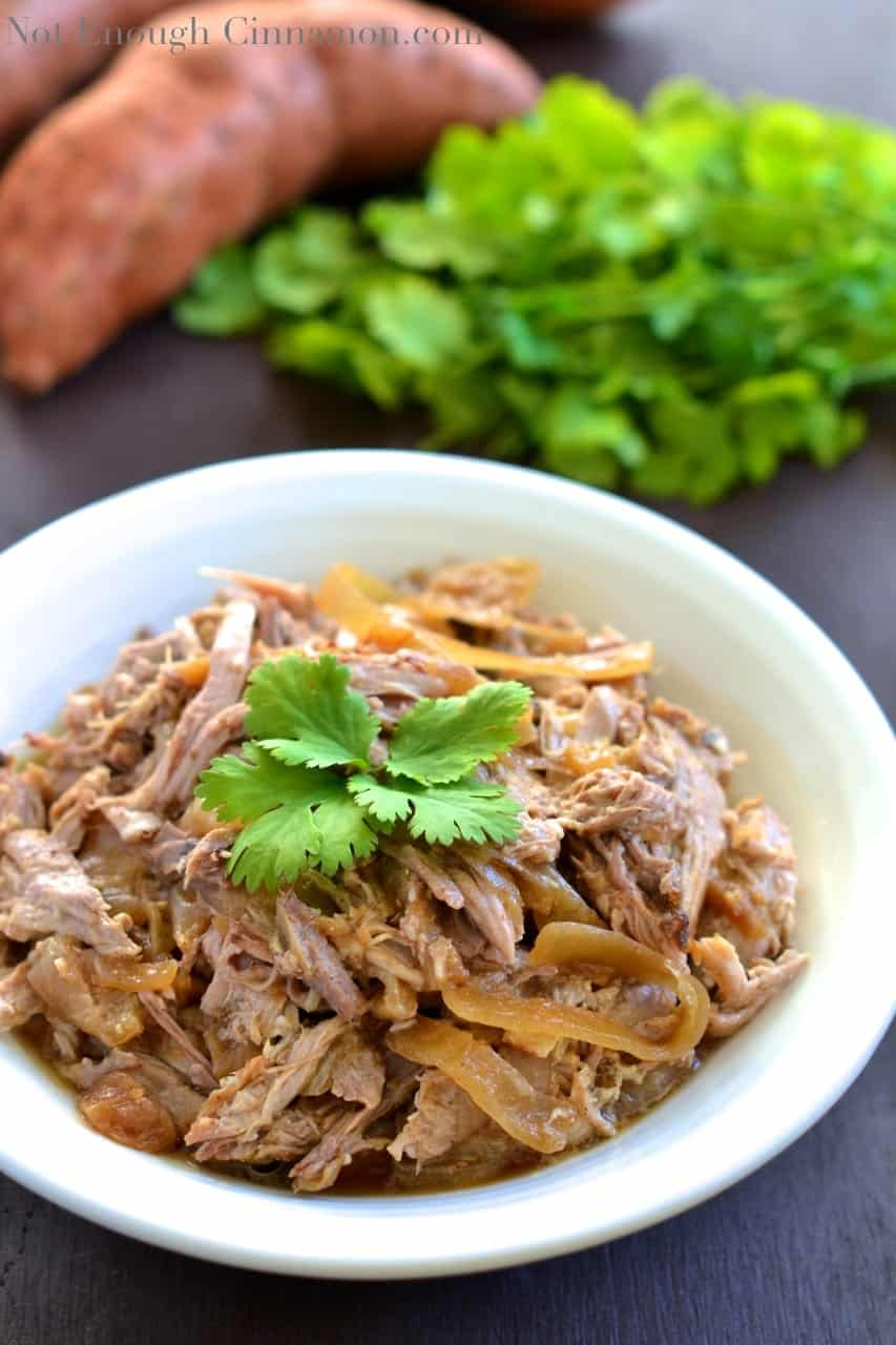 Slow Cooker Pulled Pork with Apples & Onions! In this easy recipe, pork shoulder is simmered with apples and onions until it falls apart, then shredded and tossed with the softened apples and onions.  This autumnal pulled pork recipe is great for sandwiches, tacos and more!! #lowcarb, #easy, #pork, #healthy, #dinner, #shoulder, #sandwiches