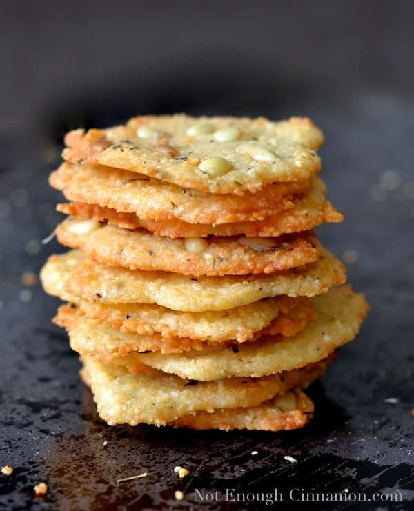 Parmesan Chips with Oregano and Pine Nut stacked on top of each other
