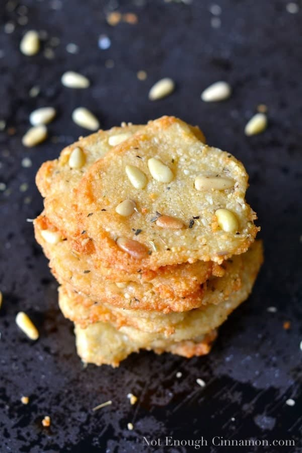 a stack of crisp Parmesan Chips with Oregano and Pine Nut