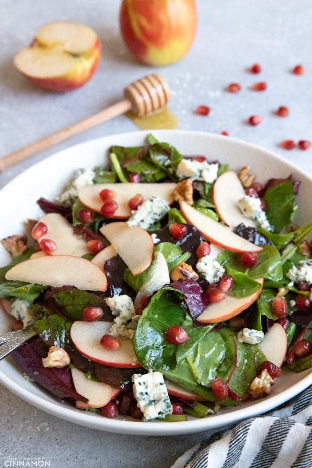 Apple and blue cheese salad in a large white serving plate