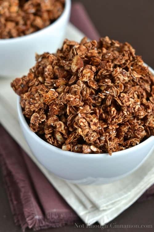 Close-up of homemade Chocolate Granola in a white breakfast bowl