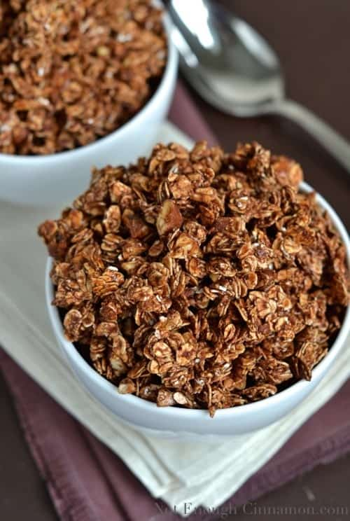 2 bowls filled with homemade chocolate granola made with sweetened condensed milk