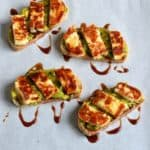 Grilled Halloumi, Avocado and Pomegranate Molasses Tartine served on parchment paper