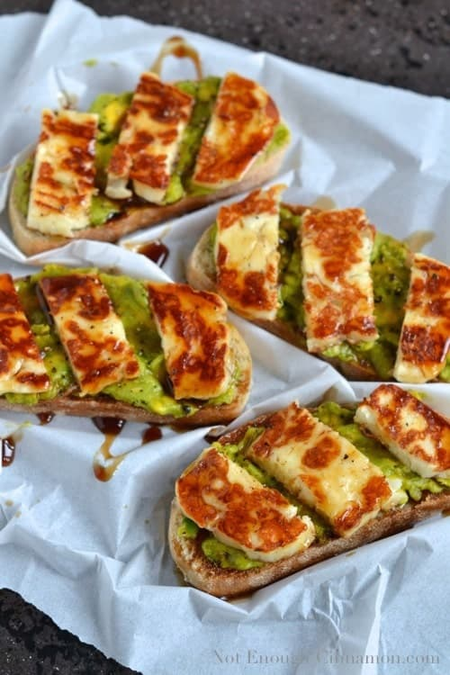 Grilled Haloumi, Avocado and Pomegranate Molasses Tartine served on a crinkled piece of parchment paper - Tartine recipe