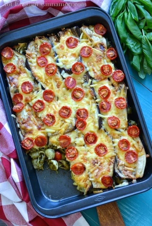 Eggplant and Pesto Baked Pasta served in a casserole dish with a chequered kitchen towel wrapped around it
