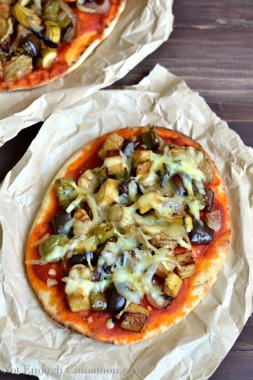 overhead shot of Gourmet Roasted Vegetable Pizza with Vegetable Pizza Toppings served in crinkled parchment paper
