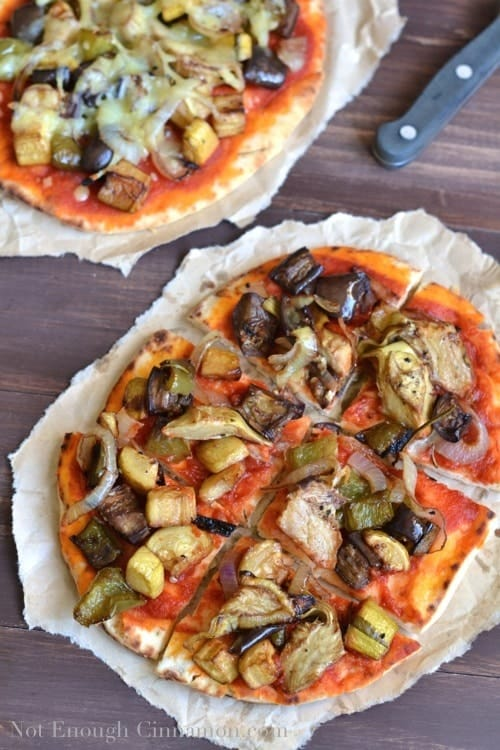 Gourmet Roasted Vegetable Pizza cut into 6 squares and served on a crinkled piece of parchment paper