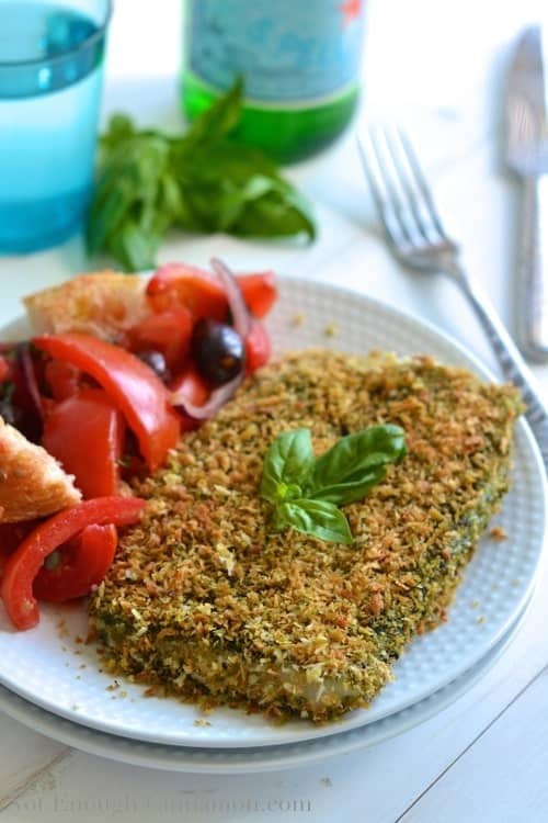 Pesto Panko Crusted Fish served on a plate with a side of panzanella salad