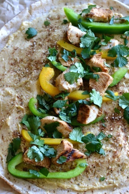 Grilled Chicken and Hummus Wrap filled with bell peppers, cilantro and za'atar spice ready to be rolled