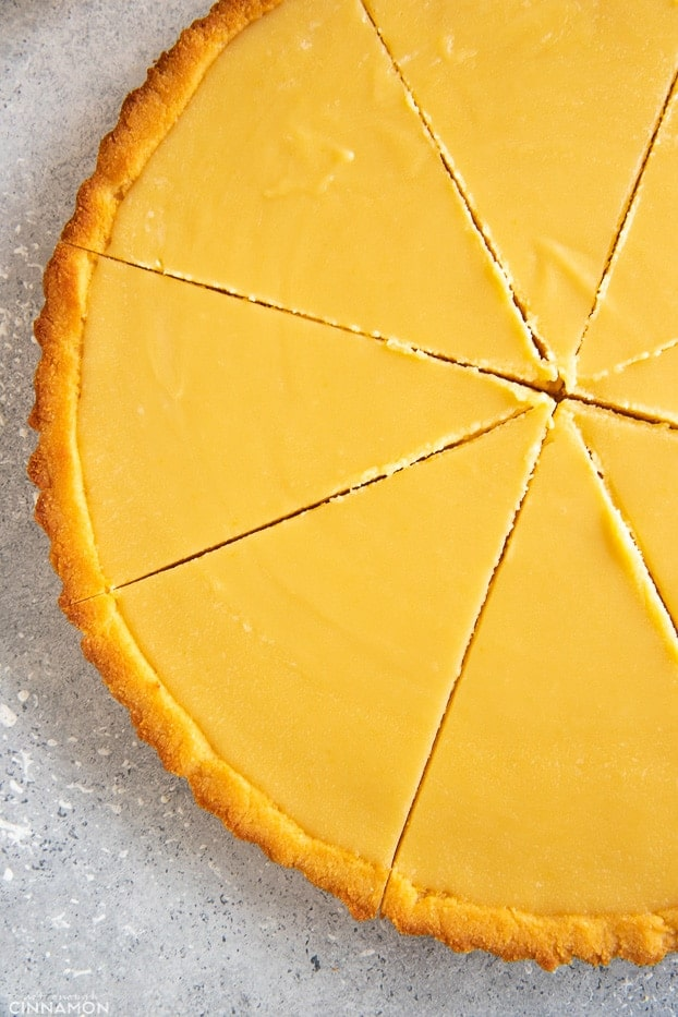 Close up on a sliced paleo lemon curd tart