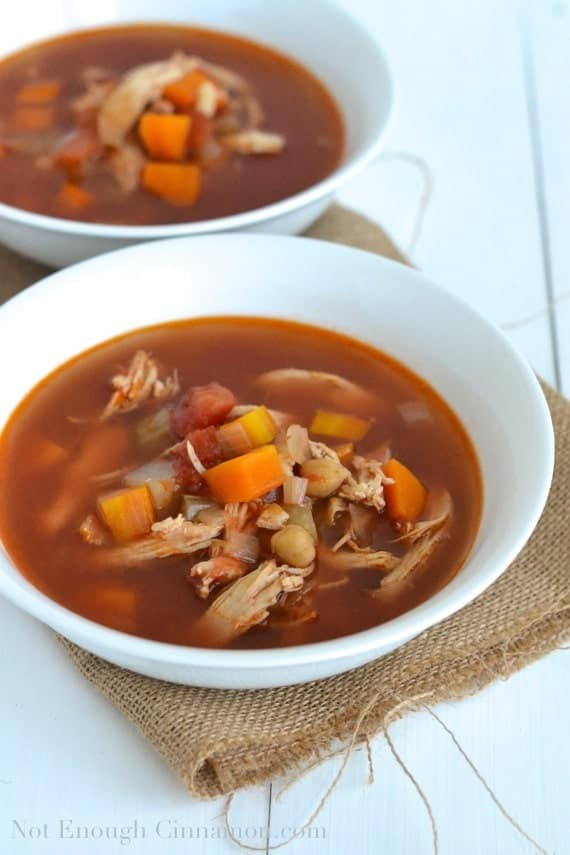 two bowls of Italian Minestrone Soup with vegetables and shredded chicken