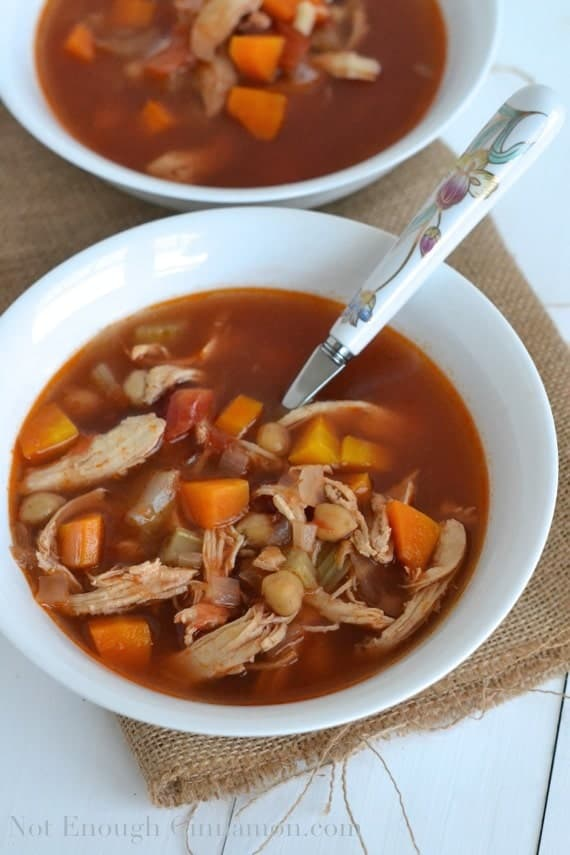 two bowls of Chicken and Vegetable Minestrone Soup served in white shallow soup bowls