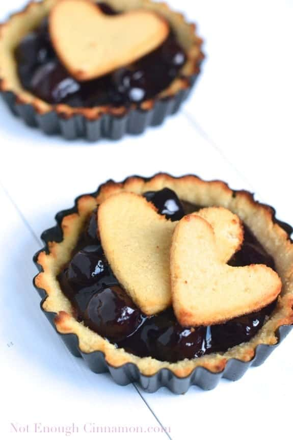 close-up of Paleo Cherry Pie topped with heart-shaped pie crust