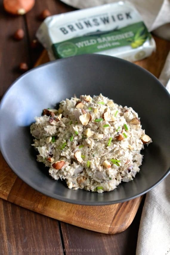 close-up of Quick and Easy Sardines Rillettes topped with chopped chives and slivered hazelnuts