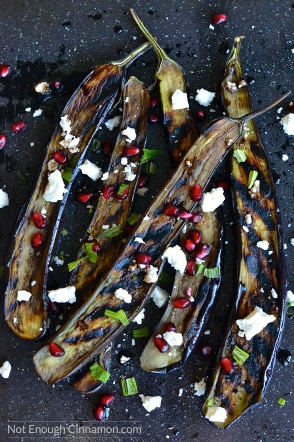 A side dish or appetizer bursting with flavors. You will go for seconds! Naturally gluten free - Grilled Eggplant with Pomegranate and Feta - NotEnoughCinnamon.com