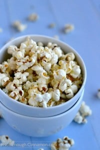 Homemade stovetop popcorn sprinkled with blue cheese and parmesan. To die for! - recipe on NotEnoughCinnamon.com