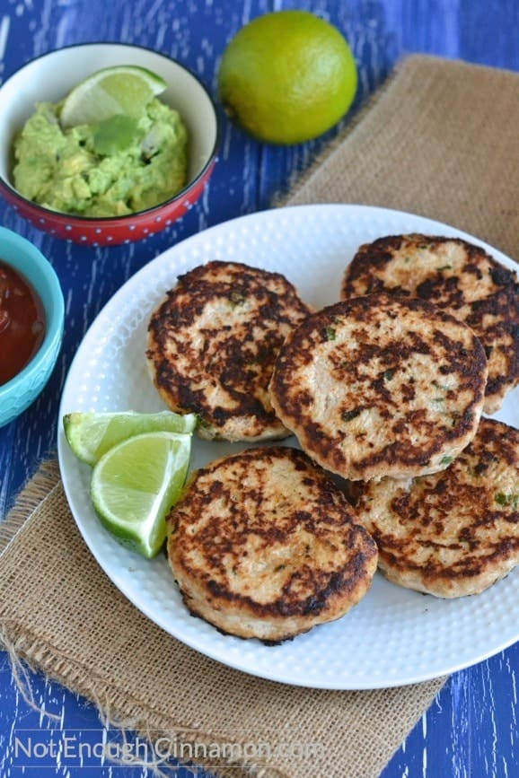 A plate with gluten free Paleo chicken patties next to Mexican salsas served in small dishes