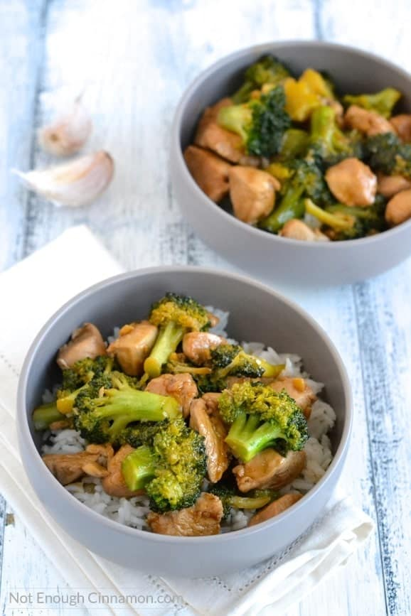 overhead shot of two bowls of Chicken and Broccoli Stir-Fry on rice