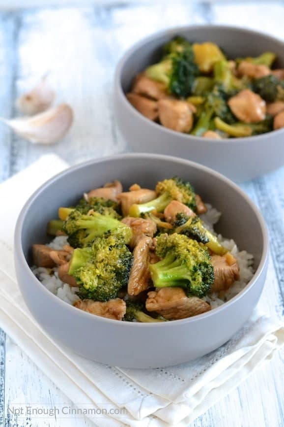 two bowls of Chicken and Broccoli Stir-Fry on a bed of rice