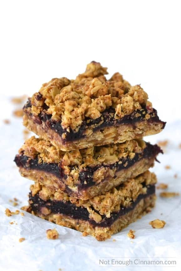 side view of a stack of Healthy Cherry Oatmeal Bars with crispy buttery oat topping and a sugar-free cherry filling