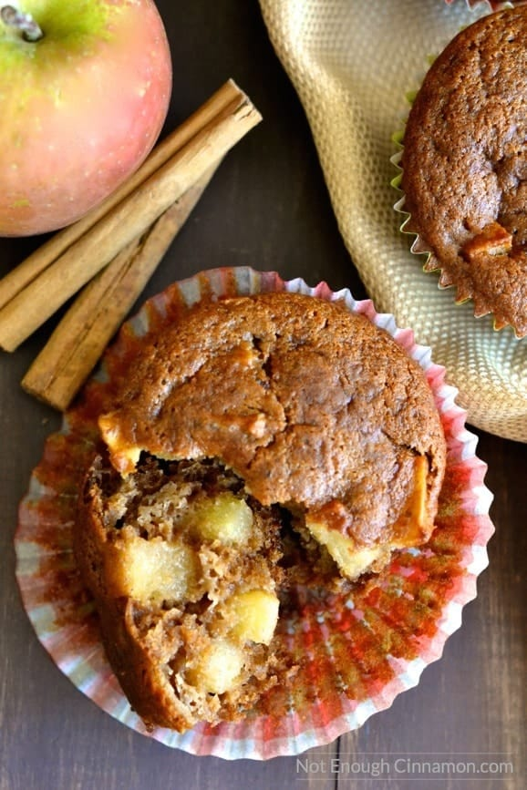 close-up of a healthy gluten-free apple spice muffin with a broken off to reveal the juice apple chunks inside