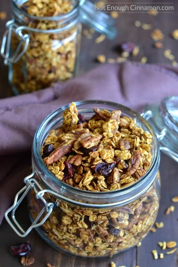 close-up of an open jar filled to the top with homemade easy pumpkin granola