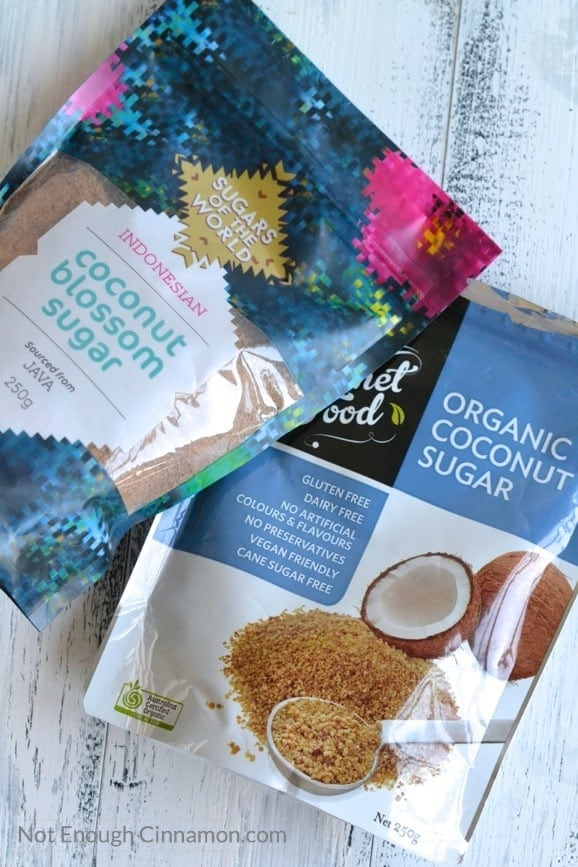 two bags of organic coconut sugar on a rustic wooden table
