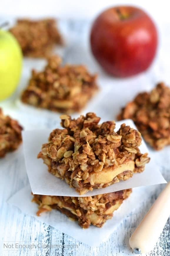 These Apple Pie Oatmeal Bars are to die for and healthier than usual. Made without refined sugar + options to turn gluten free | Find the recipe on NotEnoughCinnamon.com
