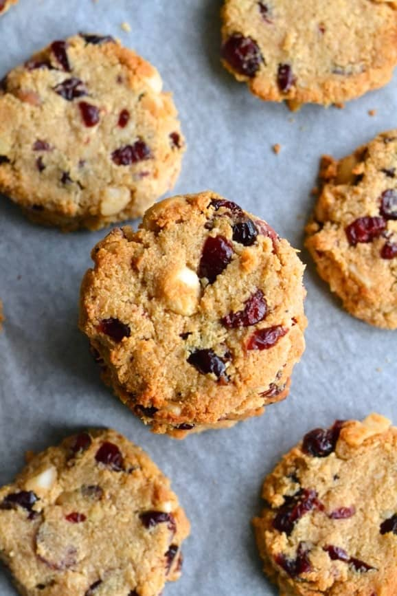 Gluten free, sugar free and dairy free paleo cookies with dried cranberries and macadamias arranged on a baking tray (paleo cookies recipe)