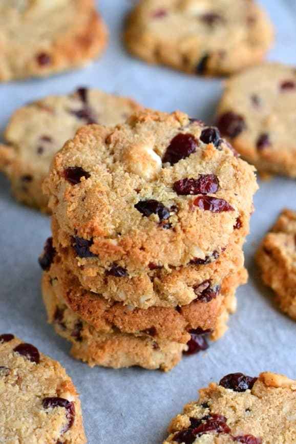 a stack of Paleo Macadamia Cranberries Cookies on a parchment-paper line baking tray