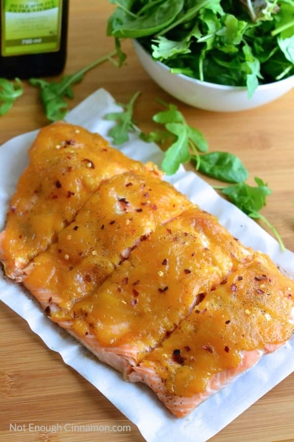 Baked salmon topped with a quick and easy mango jam. A great combination for a delicious and healthy dinner! | Find the recipe on NotEnoughCinnamon.com #glutenfree #paleo