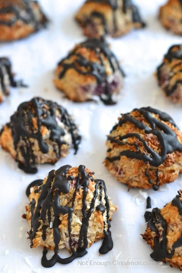 Refined sugar free, gluten free coconut macaroons with raspberries, drizzled with dark chocolate