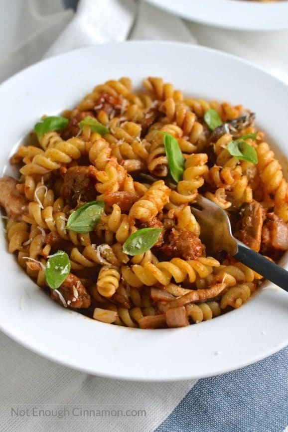 close-up of a bowl with Italian Sausage Pasta sauce tossed with fusilli noodles