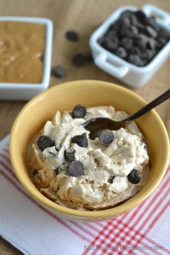 Peanut Butter Cups Healthy Frozen Yogurt served in a yellow bowl with some chocolate chips sprinkled on top