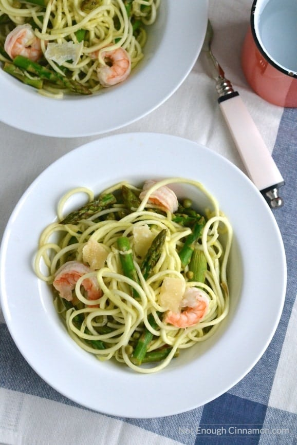 overhead shot of two bowls of Shrimp Zucchini Pasta with asparagus, peas and shrimp