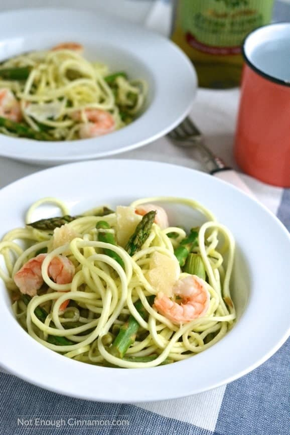 two bowls of Shrimp Zucchini Pasta made with zucchini noodles, asparagus, peas and shrimps