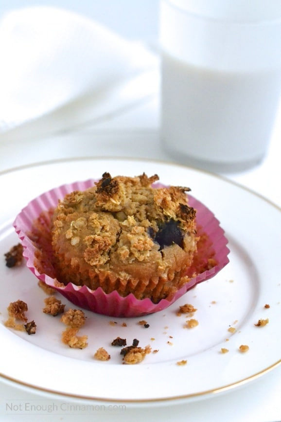 a healthy breakfast muffin with blueberries, apples and quinoa on a white plate