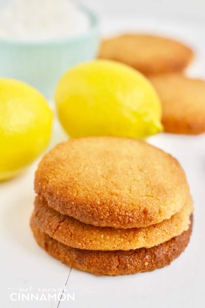soft vegan lemon coconut cookies stacked on top of each other