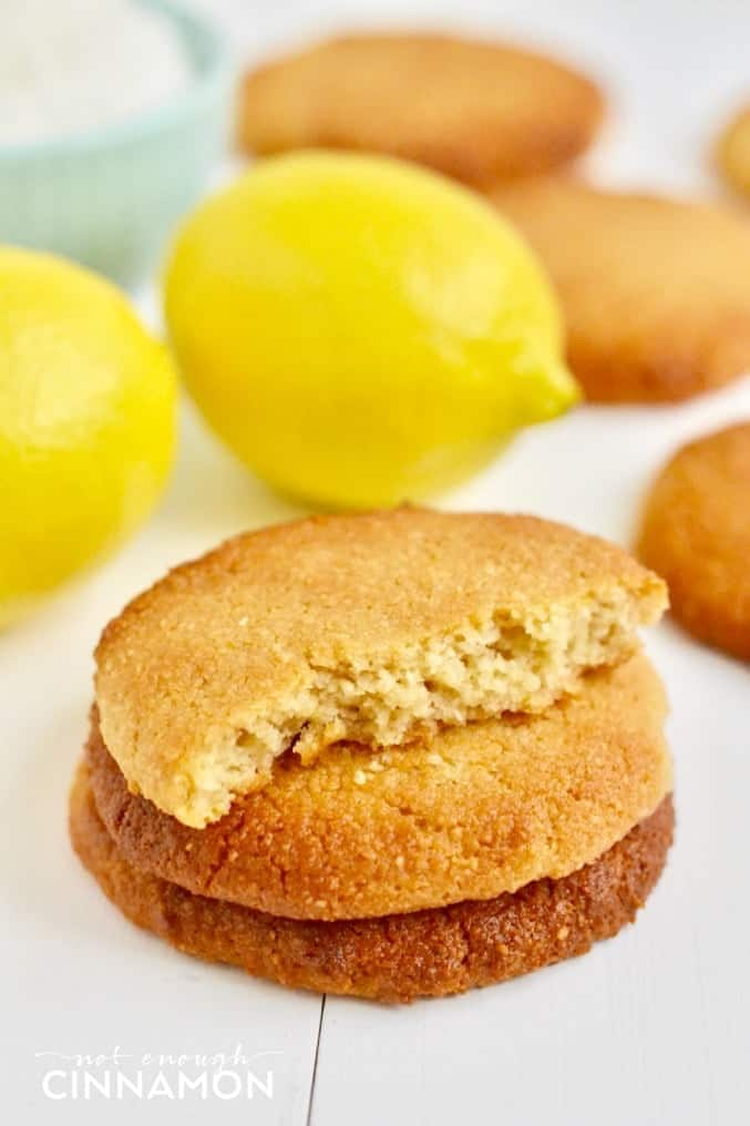 soft vegan coconut cookies with lemon stacked on top of each other