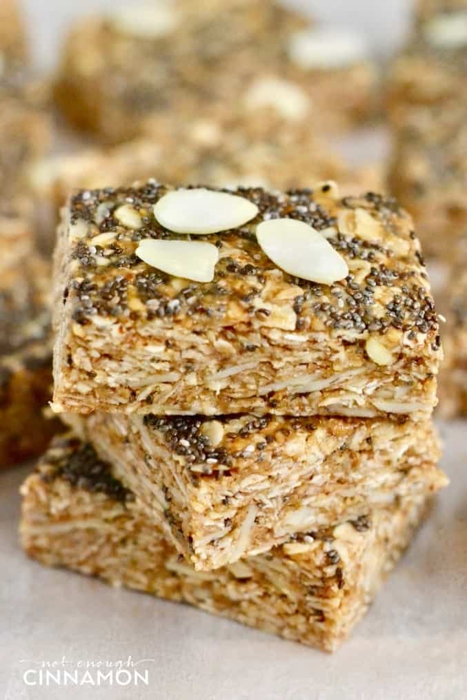 close-up of a stack of healthy no-bake oatmeal bars with chia seeds, almonds and honey