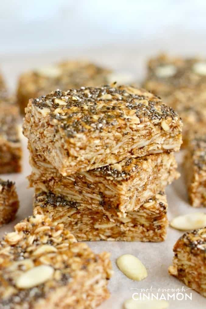 side view of a stack of no bake oatmeal bars with chia seeds, almonds and honey